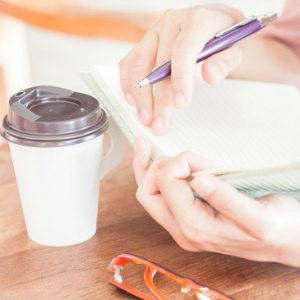 Writing time in coffee shop, stock photo